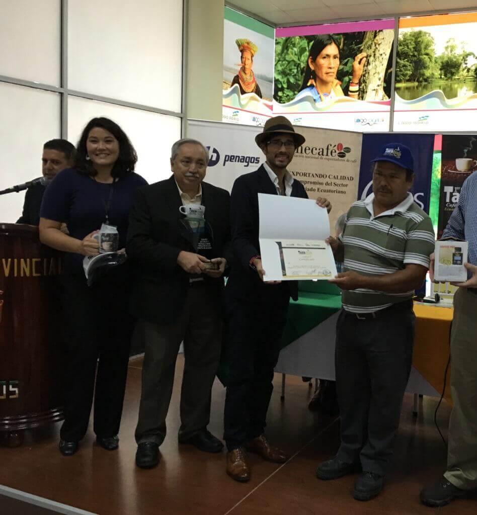 Winning Ecuadorian farmer Calixto German Rivera Narvaez poses with Miguel Meza